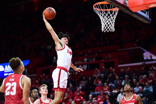 Rutgers guard Geo Baker dunks against Wisconsin.