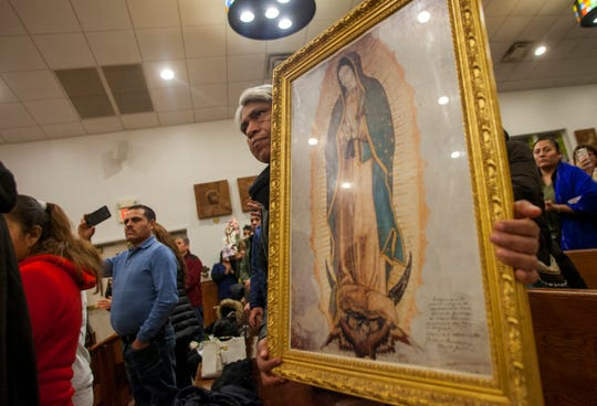 People bring with them pictures and images of Our Lady of Guadalupe to the celebration hoping that priests will bless them with holy water.