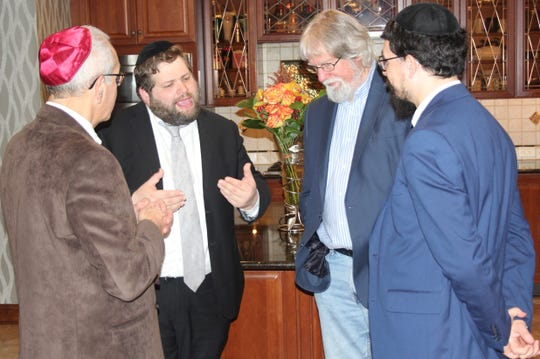 From left, the Rev. Michael Mazer, Rabbi Moshe Rotberg, Randy Bergmann and Rabbi Moshe Gourarie.