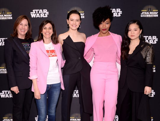"""Producers Kathleen Kennedy and Michelle Rejwan, from left, and co-stars Daisy Ridley, Naomi Ackie and Kelly Marie Tran attend """"The Rise of Skywalker"""" panel at the Star Wars Celebration at McCormick Place Convention Center on April 12, 2019 in Chicago"""