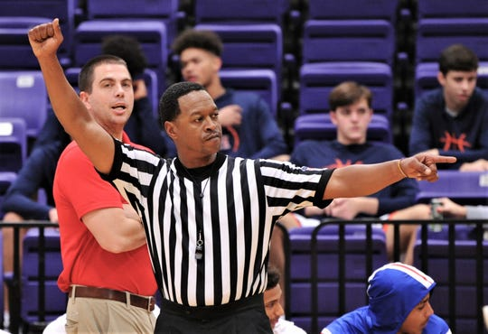 Jimmy Reed, right, signals a call while Cooper coach Bryan Conover looks on during the Cougars' game against Seminole on Thursday at Wylie's Catclaw Classic.