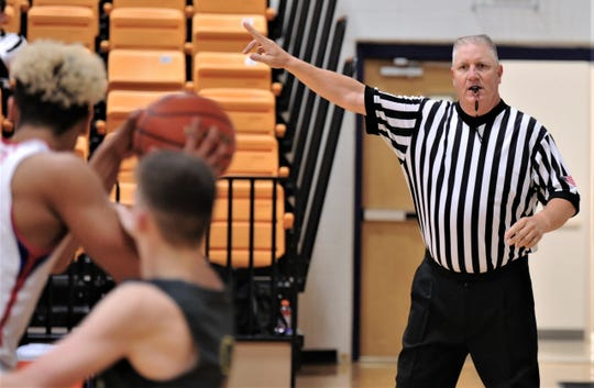 Glenn Bamlet, right, calls the Cooper-Seminole game at Wylie's Catclaw Classic on Thursday at Bulldog Gym.