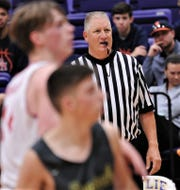 Glenn Bamlet, right, watches Cooper and Seminole play while officiating the game at the Catclaw Classic.