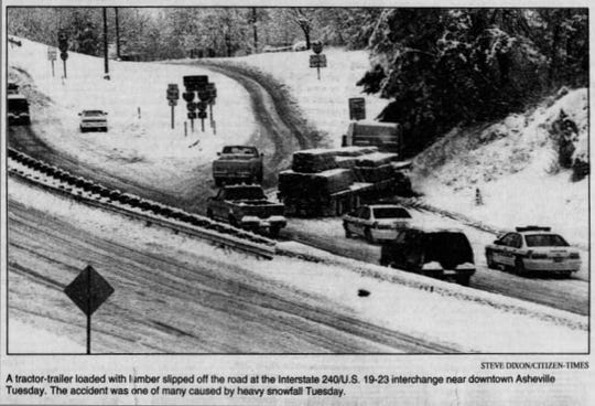 A tractor-loaded with lumber slipped off the road at the Interstate 240/U.S. 10-23 interchange near downtown Asheville. Jan. 28, 1998
