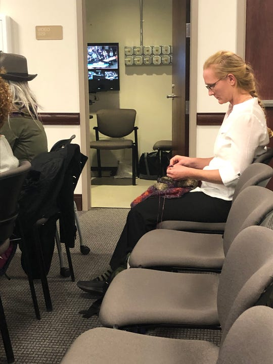 Helene Beauchamp, a neighbor of the Crossroads at West Asheville development, passed some of the time during the 7.5-hour hearing by crocheting. She was disappointed she didn't get a chance to speak, but understood the reasoning for continuing the hearing to January.