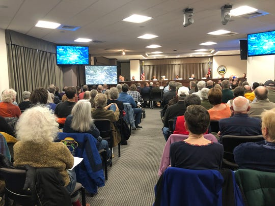 A capacity crowd filled the Buncombe County Board of Commissioners chambers for the Dec. 11 meeting of the Board of Adjustment regarding the Crossroads at West Asheville project. The crowd steadily dwindled through the day, though, as the hearing went on for more than six hours.