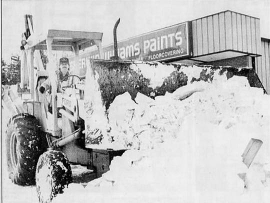 As the roads in Western North Carolina are cleared, piles of the white stuff are climbing higher and higher in other places. Don McCarn is one of those (Jan. 8, 1988) putting a plow to its rightful purpose.