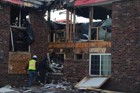 Investigators began Wednesday searching for the cause of the fire which damaged the Econo Lodge motel.