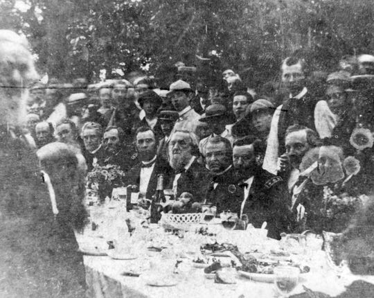 Photograph of United States President Andrew Johnson at a banquet in his honor during the Swing Around the Circle speaking tour. Johnson appears seated in the center, with General Ulysses S. Grant to his left.