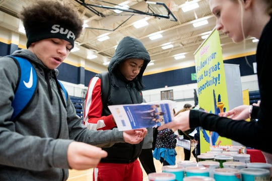 Battle Creek Central freshmen Valentino Fields and Jeremiah Smith stop by the Kellogg's table during the Career Exploration Fair on Thursday, Dec. 12, 2019 at Battle Creek Central High School in Battle Creek, Mich.