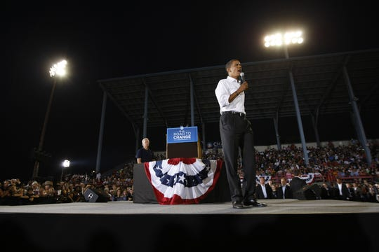 Democratic presidential candidate Barack Obama speaks while Joe Biden looks at C.O. Brown Stadium during his 2008 campaign stop in Battle Creek.