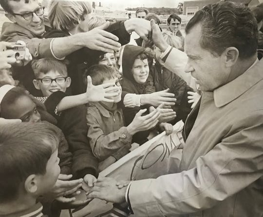 Richard Nixon shakes hands in Battle Creek while campaigning in 1968.