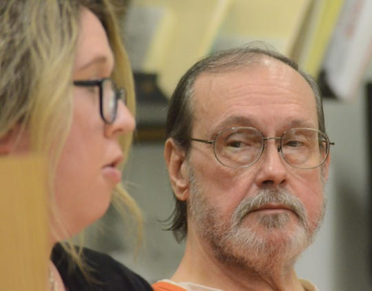 John Craig listens as his attorney, Kimberly Wickham speaks to the judge.