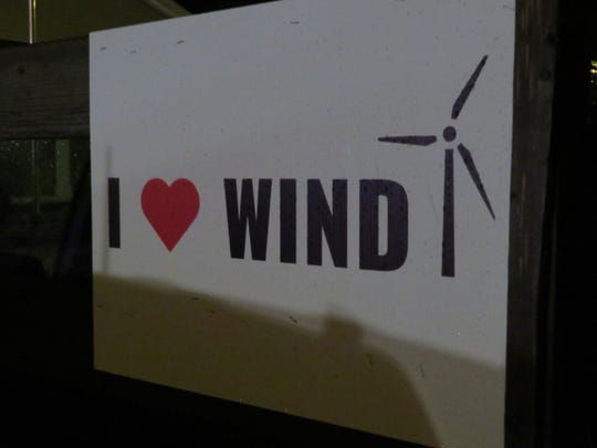 A poster in the back of a truck in the Town of Sanford. Neighbors are at odds over wind development in rural regions.