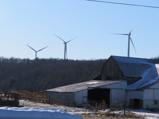 Three of 25 turbines installed on hillsides on the Town of Howard, Steuben County