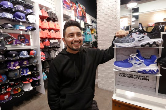 Victor Duran, a co-manager of a sports apparel store at the Southcenter mall, south of Seattle said he makes about $52,000 a year and doesn't get overtime, but is required to work at least 45 hours per week, and up to 60 during the holidays. Duran is one employee who could benefit from new overtime rules in Washington state, which will allow hundreds of thousands of workers who have been exempt to begin collecting when they work more than 40 hours per week.