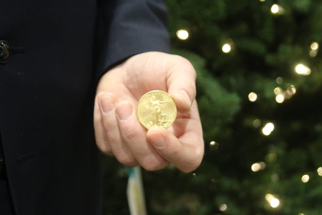 Salvation Army Captain Lance Walters holds a 2011 Liberty gold coin dropped in a red kettle in Kitsap. The piece could be worth about $1,500.