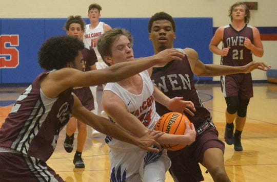Scene from the Dec. 9 boys basketball game between Owen and West Henderson at West Henderson. West Henderson won 72-56.