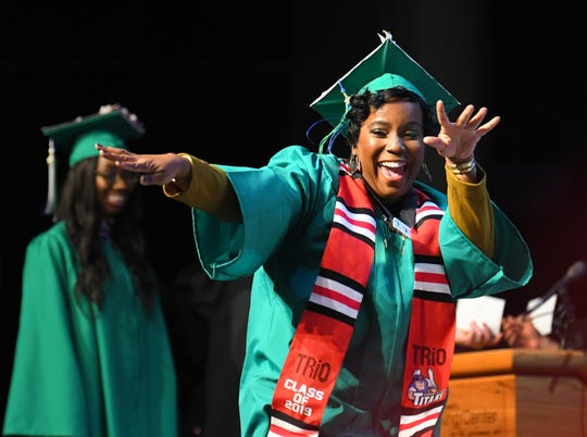 Victory dance. Kerline Prosper on stage when receiving her degree. Scenes of graduates at the Eastern Florida State College 2019 Commencement at the Melbourne campus, December 12.