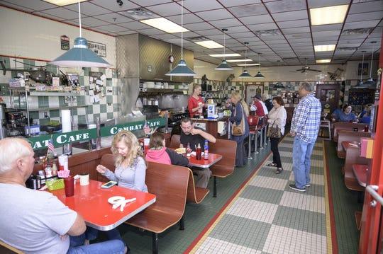 Guests dine at Combat Cafe in Eustis.