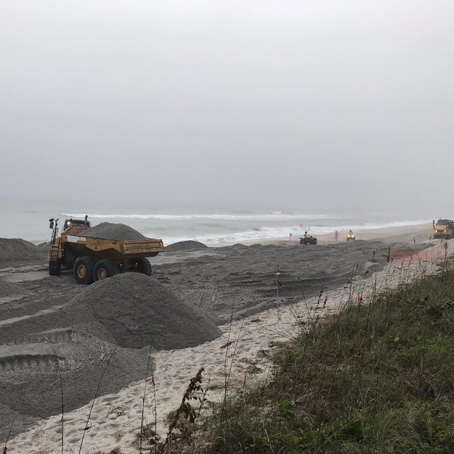 Workers Wednesday (12/11/2019) spread sand on beaches just north of Indialantic in the Mid-Reach nourishment area.