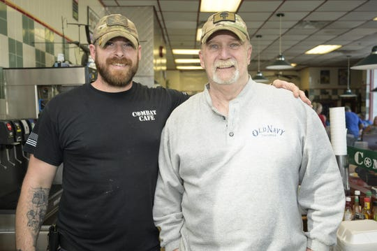 Combat Cafe owner Bruce Chambers is pictured with David King, a regular customer and son of the late Vinny King, who the Vinny's SOS is named after. In honor of his father, David paid for every customer's meal on Dec. 7, one year after his father passed away.