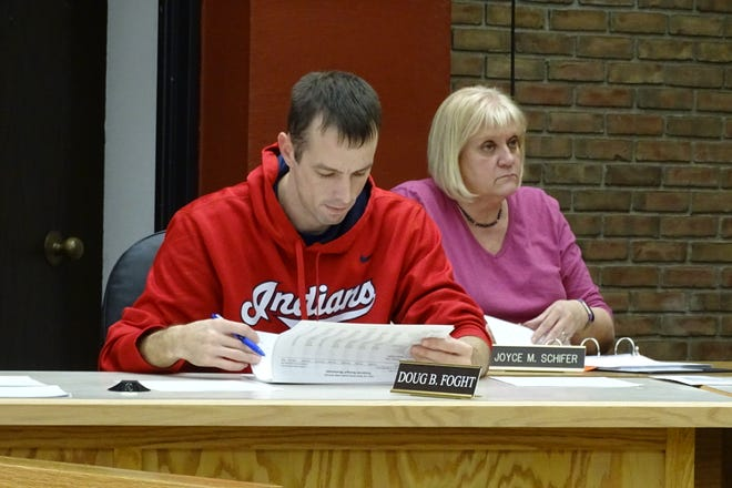 Bucyrus City Council member Doug Foght and city auditor Joyce Schifer listen to debate during a finance committee meeting on the city's 2020 budget on Wednesday evening.