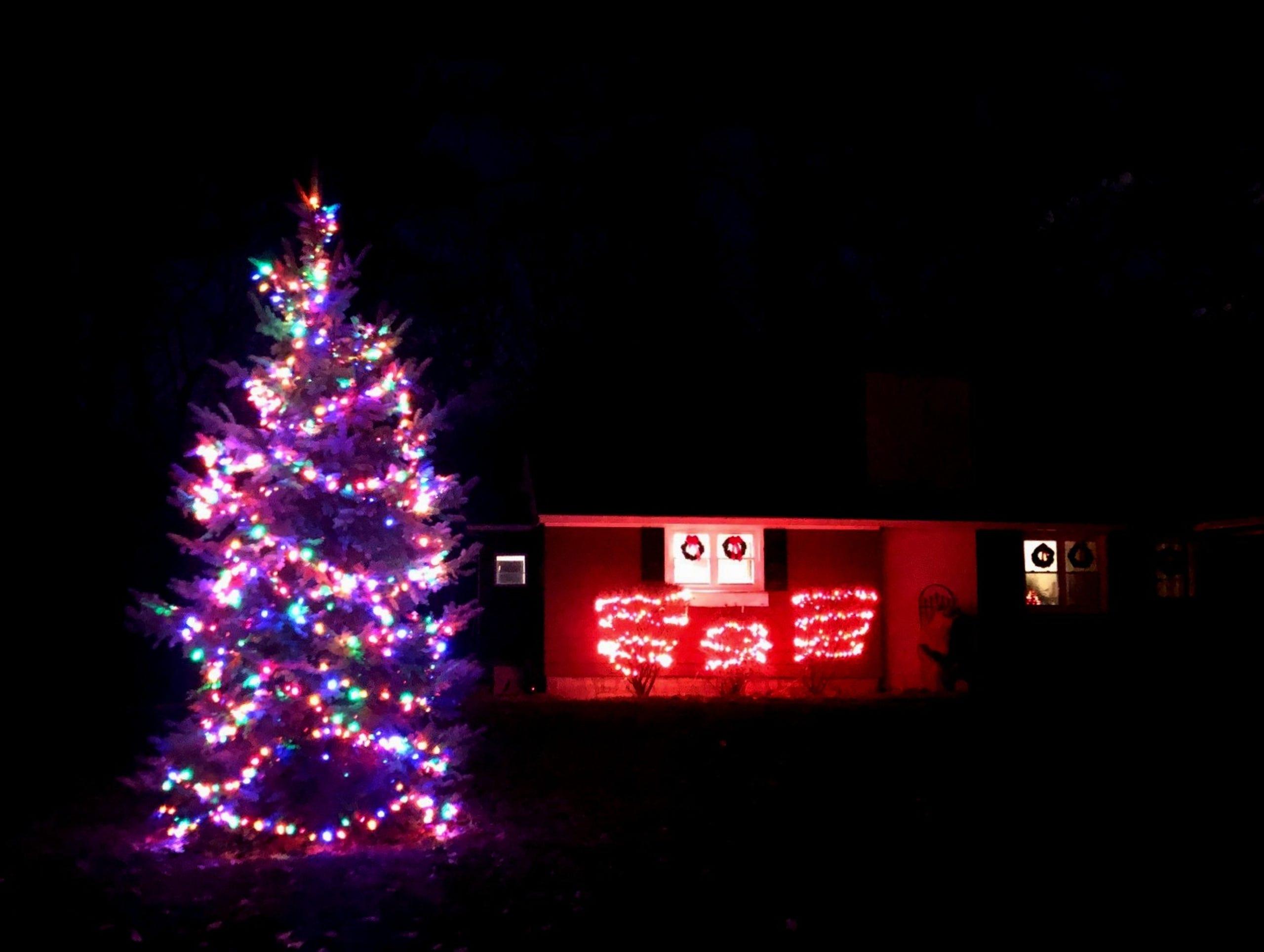 Festive lights adorn a house in South Burlington on Wednesday, Dec. 11, 2019.
