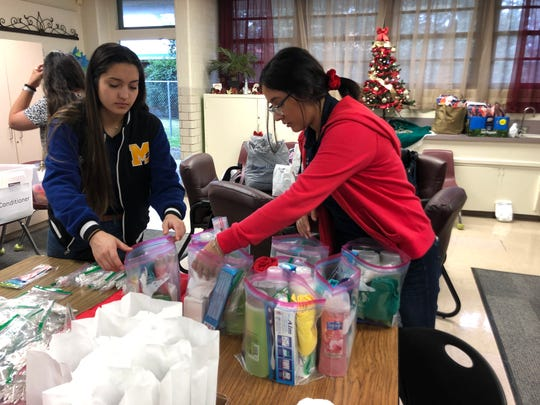Moody High School senior Belize Garcia and Branch Academy junior Jaelyn Zambrano put together toiletry bags for students in need at the Lozano Instructional Service Center on Wednesday, Dec. 11, 2019.