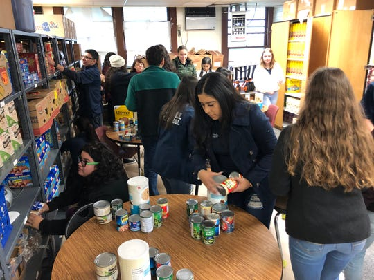 Corpus Christi high school student ambassadors help organize food boxes for students in need at the Lozano Instructional Services Center on Wednesday, Dec. 11, 2019.