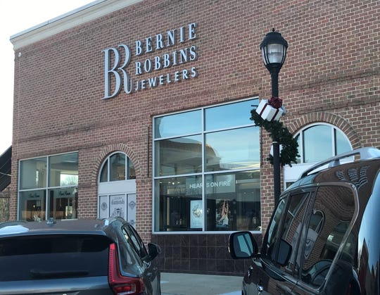 A man accused of buying a $52,000 Rolex watch with a worthless check at Bernie Robbins Jewelers in Evesham has pleaded guilty to multiple crimes in federal court.      a