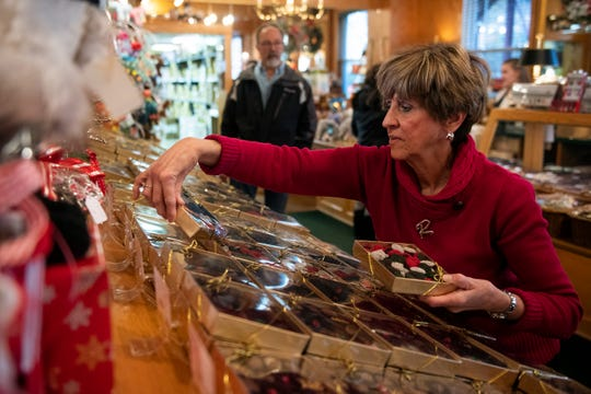 Randy Oakford organizes boxes of chocolates at Aunt Charlotte's Candies Wednesday, Dec. 11, 2019 in Merchantville, N.J.