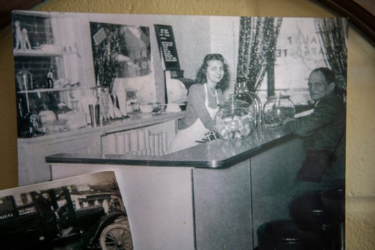 Bunny Oakford behind the counter. Bunny recently passed away at 93.