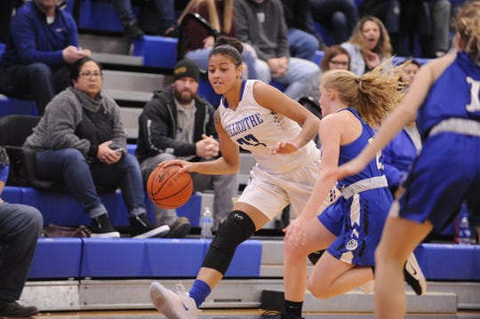 Chillicothe's Shawnice Smith dribbles the ball during Chillicothe's 54-47 win over Washington on Wednesday Dec. 11, 2019 at Chillicothe High School in Chillicothe, Ohio.