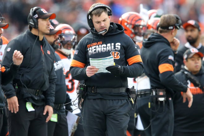 Cincinnati Bengals head coach Zac Taylor looks at his play card in the first quarter during a Week 14 NFL football game against the Cleveland Browns, Sunday, Dec. 8, 2019, at FirstEnergy Stadium in Cleveland.