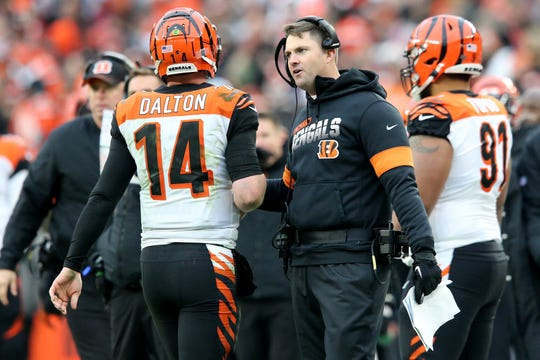 Cincinnati Bengals quarterback Andy Dalton (14) walks past Cincinnati Bengals head coach Zac Taylor after a fourth-down play in the fourth quarter during a Week 14 NFL football game against the Cleveland Browns, Sunday, Dec. 8, 2019, at FirstEnergy Stadium in Cleveland. The Cleveland Browns won 27-19, and the Cincinnati Bengals fell to 1-12 on the season.