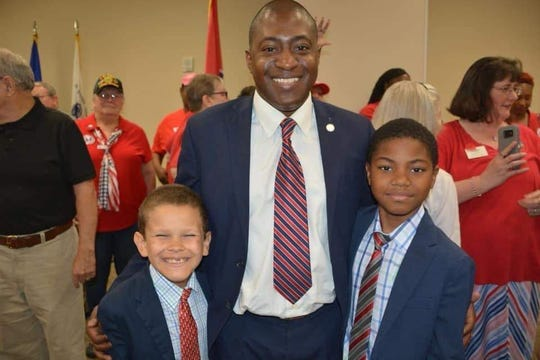 Montgomery County Commissioner Jason Knight stands with two of his sons.