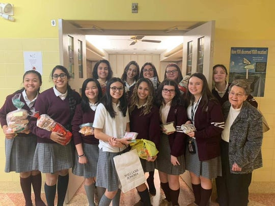 Sister Mary Anne Katlack (right) along with students who donated sandwiches