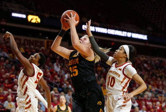 Iowa sophomore Monika Czinano posts up under the basket in the first quarter against Iowa State during the CyHawk Series women's basketball game on Wednesday, Dec. 11, 2019, at Hilton Coliseum in Ames, Iowa.