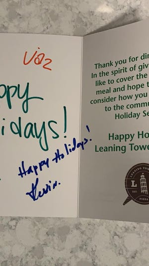 After enjoying a meal at the Leaning Tower of Pizza in Ankeny, Jaime Robinson received a card telling her that her meal was covered by the restaurant.