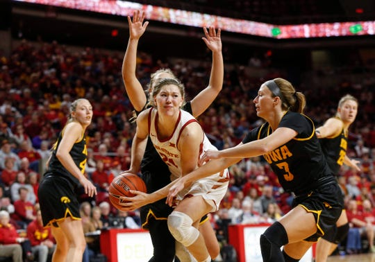 Iowa State sophomore Ashley Joens maintains control of the ball as she drives in against Iowa during the CyHawk Series women's basketball game on Wednesday, Dec. 11, 2019, at Hilton Coliseum in Ames, Iowa.