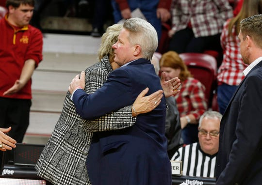 Bill Fennelly gets a hug from Iowa women's basketball head coach Lisa Bluder after the Dec. 11 game at Hilton Coliseum in Ames.