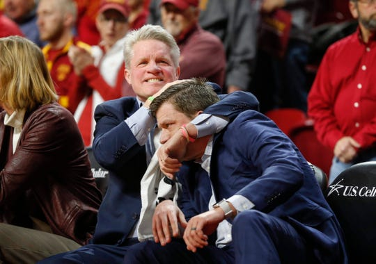 Iowa State women's basketball head coach Bill Fennelly hugs his son, assistant coach Billy Fennelly, after a moment of silence for his father before the Iowa game.