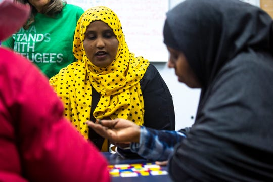 Barwaqo Aden, assistant director at NISAA Des Moines, volunteers as a mentor to students in an English Language Learner class on Wednesday, Dec. 11, 2019, in Norwalk.