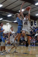 Martensdale-St. Marys junior Jerry Archibald shoots over East Union sophomore Cole Eklund. The Martensdale-St. Marys boys improved to 3-1 beating East Union 82-35 in Martensdale on Dec. 10.