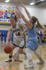 Martensdale-St. Marys sophomore Anna Parrott pushes through a double team. The Martensdale-St. Marys girls improved to 6-1 beating East Union 80-30 in Martensdale on Dec. 10.
