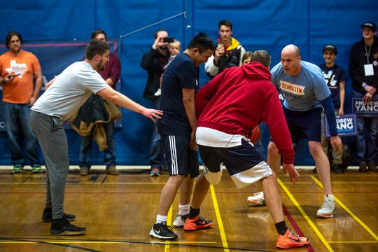 Democratic Presidential Candidate Andrew Yang plays a three-on-three basketball game with Iowa Politician J.D. Scholten on Thursday, Dec. 12, 2019, at the Ames Community Center.