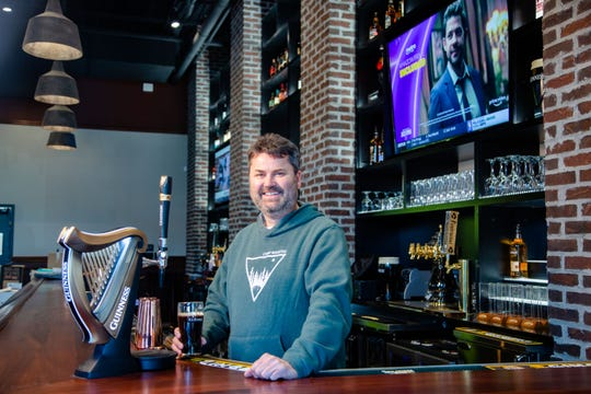 Andrew Martin pours a Guinness at his new restaurant Magee's Irish Pub & Eatery in Ankeny Wednesday, Dec. 11, 2019.