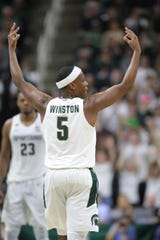 Michigan State guard Cassius Winston celebrates a 3-pointer against Rutgers, Sunday, Dec. 8, 2019 at the Breslin Center in East Lansing.