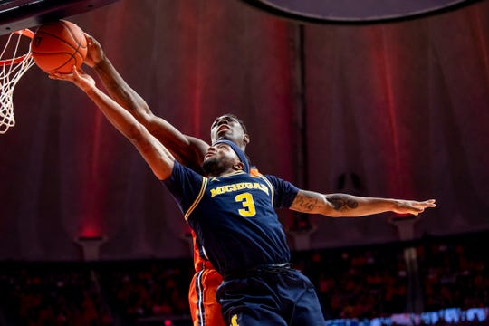 Illinois center Kofi Cockburn blocks a shot against Zavier Simpson during U-M's 71-62 loss Dec. 11, 2019, in Champaign, Ill.